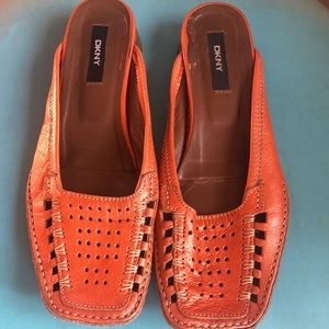 Metallic orange leather slip on loafers